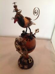 Bird on Brown Ball