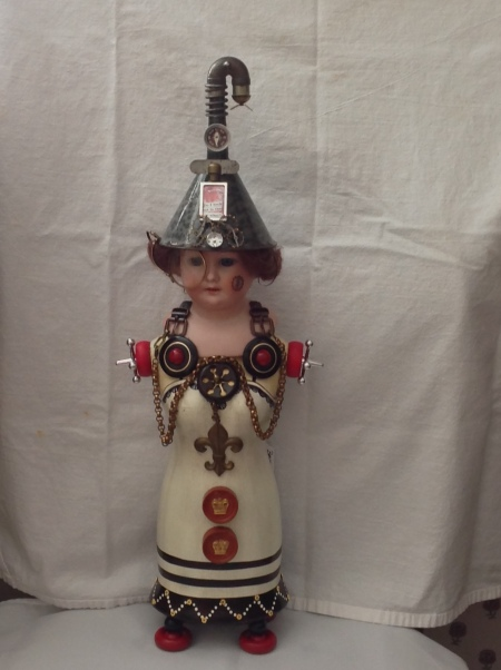 Doll with metal hat